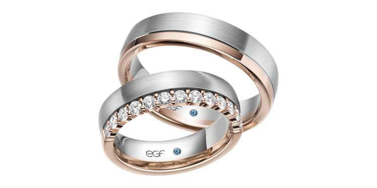 Trouwringen in twee kleuren, rosé en grijsgoud aan rand half gezet met diamant 0.02ct